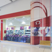 View of retail shop, with red framing around outlet store, product, retail, shopping mall, gray