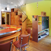 view of kitchen showing stairway leading to next architecture, ceiling, floor, flooring, home, interior design, kitchen, living room, loft, orange, real estate, room, table, wall, red, gray