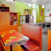 view of kitchen with stairway in the background, countertop, home, interior design, kitchen, orange, real estate, room, table, yellow, red