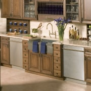 View of Asko appliance dishwashers. - View of cabinetry, countertop, cuisine classique, drawer, flooring, furniture, hardwood, kitchen, wood stain, brown, gray