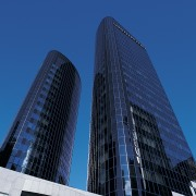 View of the Kiwi Income Property Managment offices architecture, building, city, cityscape, commercial building, condominium, corporate headquarters, daytime, downtown, facade, headquarters, landmark, metropolis, metropolitan area, reflection, sky, skyline, skyscraper, tower, tower block, urban area, blue