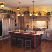view of kitchen featuring cabinetry, wooden floors, countertops, cabinetry, countertop, cuisine classique, floor, flooring, hardwood, home, interior design, kitchen, room, wood, wood flooring, red, orange