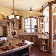 view of kitchen featuring cabinetry, wooden floors, lighting, cabinetry, ceiling, countertop, cuisine classique, estate, home, interior design, kitchen, real estate, room, window, orange