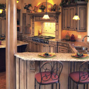 view of kitchen featuring cabinetry, wooden floors, lighting, cabinetry, countertop, flooring, home, interior design, kitchen, room, table, red, orange