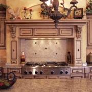 view of kitchen featuring cabinetry, wooden floors, lighting, cabinetry, countertop, cuisine classique, flooring, furniture, interior design, kitchen, room, under cabinet lighting, red, orange