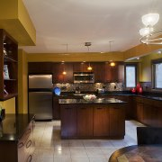 Cabintery Kitchen with black granite countertops, with glass cabinetry, ceiling, countertop, cuisine classique, home, interior design, kitchen, real estate, room, brown, red