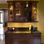 Cabinet Desk and display space with glass countertop cabinetry, countertop, furniture, interior design, kitchen, shelf, shelving, table, brown, red