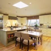 Pale yellow contemporary kitchen - Pale yellow contemporary cabinetry, countertop, cuisine classique, flooring, interior design, kitchen, real estate, room, orange, brown