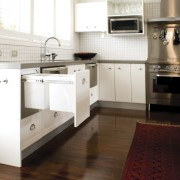 Hideaway Bins from Kitchen King roll out of cabinetry, countertop, cuisine classique, floor, flooring, hardwood, home appliance, interior design, kitchen, kitchen stove, laminate flooring, room, tile, wood flooring, white