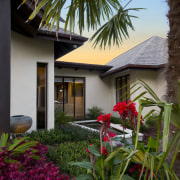 Exterior view of resort-style home designed by Masonry architecture, arecales, cottage, estate, flora, home, house, palm tree, plant, property, real estate, resort, tree, tropics, window