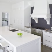 The rangehood provides a counterpoint to more midern cabinetry, countertop, cuisine classique, floor, home, interior design, kitchen, room, white, gray