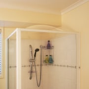 Image of a Showerdome shower which reduces the bathroom, ceiling, floor, home, interior design, plumbing fixture, property, room, wall, orange