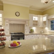 View of traditional styled kitchen in a new cabinetry, ceiling, countertop, cuisine classique, estate, flooring, home, interior design, kitchen, living room, real estate, room, orange