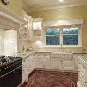 View of traditional styled kitchen in a new cabinetry, ceiling, countertop, cuisine classique, floor, flooring, hardwood, home, interior design, kitchen, room, tile, under cabinet lighting, window, wood flooring, orange