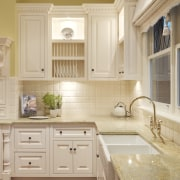 View of traditional styled kitchen in a new bathroom, bathroom accessory, bathroom cabinet, cabinetry, countertop, cuisine classique, floor, flooring, hardwood, home, interior design, kitchen, room, sink, tile, window, wood flooring, wood stain, orange