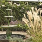 View of garden which features an antique fountain backyard, botanical garden, garden, grass, grass family, landscape, landscaping, outdoor structure, plant, shrub, water feature, yard, brown
