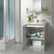 View of a bathroom which features a macerating bathroom, bathroom accessory, bathroom cabinet, furniture, interior design, plumbing fixture, product design, shelf, sink, tap, gray