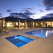 View of outdoor area, pool and spa which estate, home, house, leisure, lighting, property, real estate, reflection, resort, sky, swimming pool, villa, blue