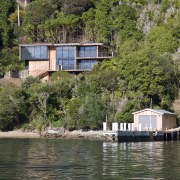 Exterior view of house and original boat shed cottage, home, house, lake, plant, property, real estate, reflection, reservoir, river, tree, water, waterway, brown