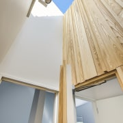 An ash timber-clad feature wall in this lightwell
