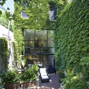 This Victorain row house has one advantage over backyard, cottage, courtyard, garden, home, house, outdoor structure, plant, property, real estate, shrub, tree, yard, green