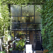 This Victorain row house has one advantage over architecture, backyard, courtyard, garden, home, house, outdoor structure, patio, plant, tree, yard, green