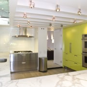View of kitchen with lime-green cabinetry, marble benchtops, ceiling, interior design, interior designer, kitchen, real estate, room, white