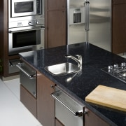 This kitchen features the new DCS built-in RF48SS cabinetry, countertop, home appliance, kitchen, kitchen stove, sink, black