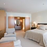 View of bedroom featuring bedroom room furnishings, artwork, bedroom, ceiling, hotel, interior design, real estate, room, suite, gray
