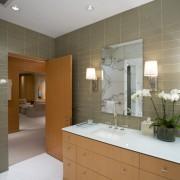 View of bathroom featuring vanity, basin, tapware, mirror, architecture, bathroom, bathroom accessory, bathroom cabinet, cabinetry, ceiling, countertop, home, interior design, kitchen, product design, room, sink, gray, brown