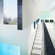 The pool is tiled in metalic mosaics that apartment, architecture, condominium, daylighting, glass, house, interior design, swimming pool, white