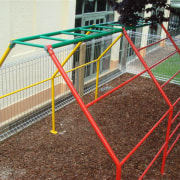 Image of outdoor play equipment created by Adams fence, line, net, outdoor play equipment, playground, public space, recreation, structure, brown