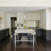 View of contemporary kitchen in this century-old house cabinetry, countertop, cuisine classique, floor, flooring, hardwood, interior design, kitchen, laminate flooring, room, wood flooring, gray, black