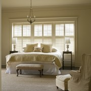 View of master bedroom which features painted shutters, bed frame, bedroom, ceiling, curtain, estate, floor, furniture, home, interior design, living room, room, wall, window, window blind, window covering, window treatment, wood, brown, gray