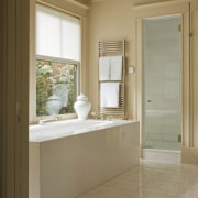 View of the master bathroom which features marble bathroom, bathroom accessory, bathroom cabinet, floor, home, interior design, real estate, room, sink, window, brown, orange