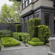 Exterior view of century old house featuring landscaping, architecture, backyard, courtyard, estate, facade, garden, grass, home, house, landscape, landscaping, lawn, mansion, neighbourhood, plant, property, real estate, residential area, shrub, tree, walkway, window, yard, gray