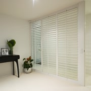This downstairs area is a self-contained master suite curtain, door, interior design, real estate, room, wall, window, window blind, window covering, window treatment, wood, gray