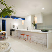 View of the kitchen area which features a home, interior design, real estate, room, table, gray