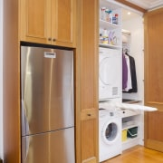 view of a renovated kitchen where Swamp kauri cabinetry, cupboard, furniture, home appliance, kitchen, major appliance, product, refrigerator, room, orange