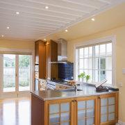 view of a renovated kitchen where Swamp kauri ceiling, countertop, daylighting, floor, flooring, hardwood, interior design, kitchen, real estate, room, window, wood flooring, gray