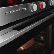 This 30-inch stainless steel oven features an intelligent electronic instrument, electronics, gas stove, home appliance, kitchen appliance, kitchen stove, major appliance, musical instrument accessory, oven, black