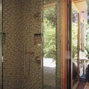 Image of a bathroom with colours that mimic bathroom, door, floor, flooring, glass, home, interior design, plumbing fixture, real estate, room, wall, window, brown