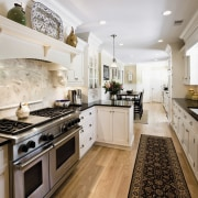 View of a kitchen which was designed by cabinetry, countertop, cuisine classique, home, interior design, kitchen, real estate, room, gray