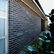 The use of smiliar materials both outside and architecture, building, daylighting, facade, glass, home, house, residential area, siding, wall, window, black