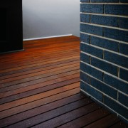 The use of smiliar materials both outside and angle, architecture, daylighting, floor, flooring, hardwood, house, laminate flooring, light, line, sunlight, wall, wood, wood flooring, wood stain, black