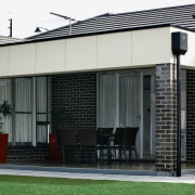 The dark-grey Liquorice PGH clay bricks have been facade, house, residential area, shade, structure, window, black