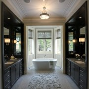 The free standing tub is the focal point bathroom, cabinetry, ceiling, countertop, estate, floor, flooring, home, interior design, kitchen, room, window, gray, black