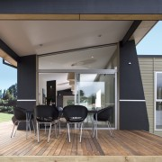 The design of Axis includes a covered deck architecture, door, house, interior design, real estate, shade, window, gray, black