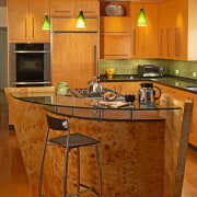 The focal point of this kitchen is the cabinetry, countertop, cuisine classique, floor, flooring, furniture, hardwood, interior design, kitchen, laminate flooring, room, table, wood, wood flooring, brown