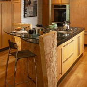 The focal point of this kitchen is the cabinetry, countertop, cuisine classique, floor, flooring, hardwood, interior design, kitchen, laminate flooring, room, under cabinet lighting, wood, wood flooring, brown